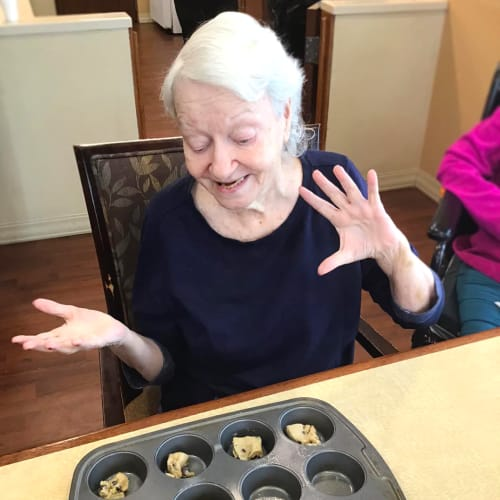 Resident making cupcakes at Oxford Glen Memory Care at Grand Prairie in Grand Prairie, Texas