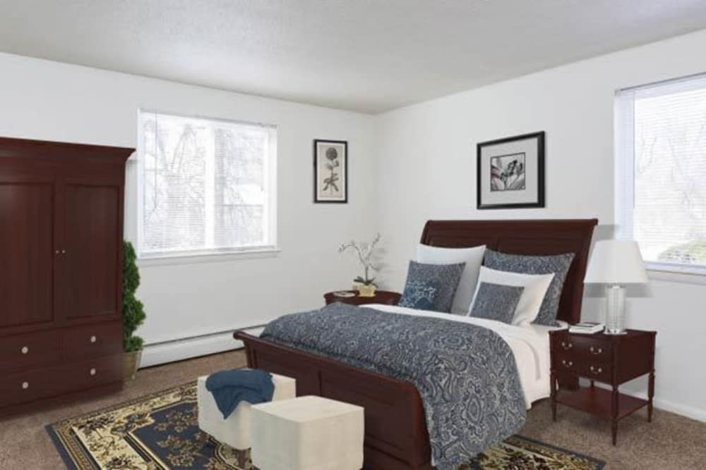 Luxury bedroom at Perinton Manor Apartments in Fairport