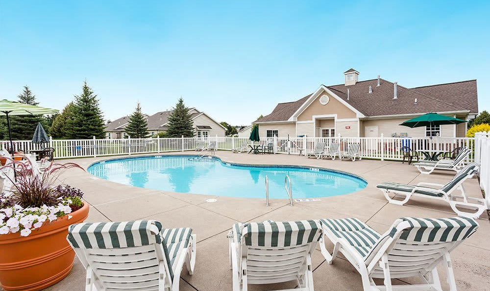 Sparkling swimming pool at Villas of Victor and Regency Townhomes in Victor