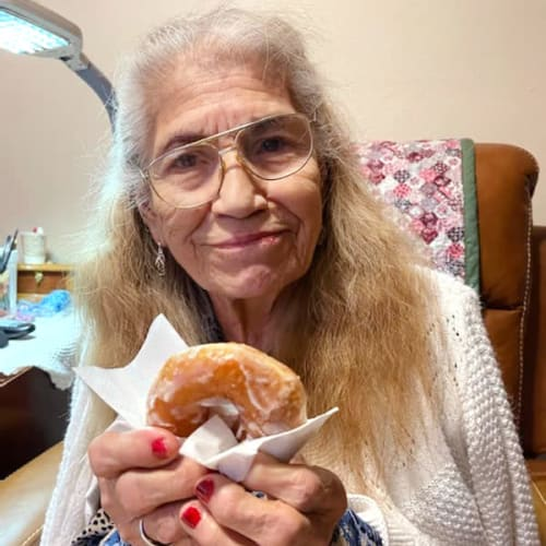 Resident holding a donut at Alderbrook Village in Arkansas City, Kansas