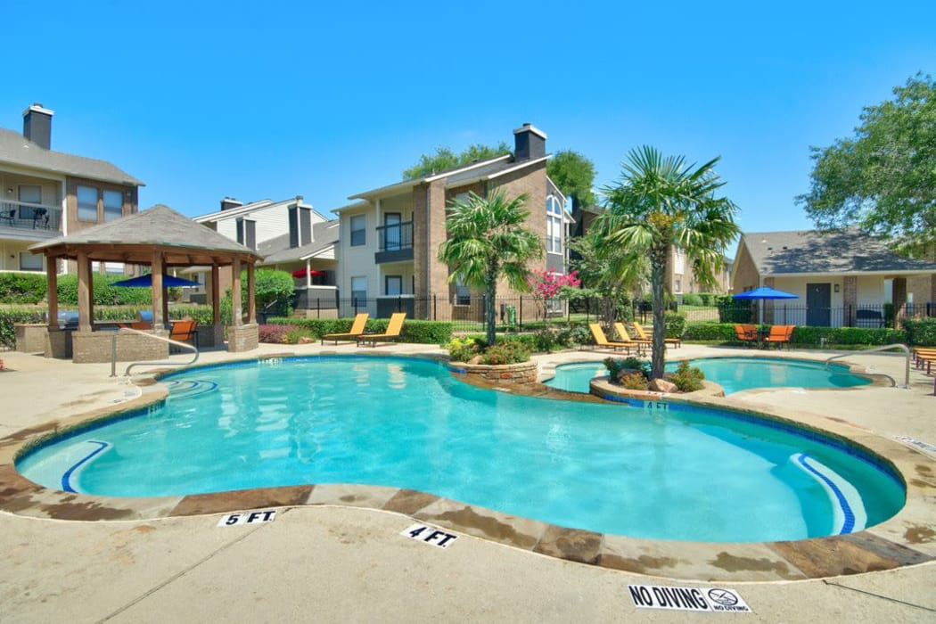 Gorgeous swimming pool area on a beautiful day at Ridgeview Place in Irving, Texas