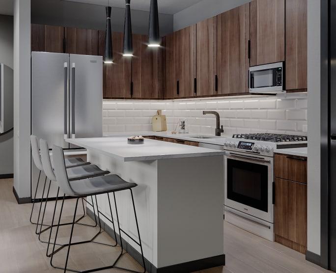 Sleek modern kitchen at Solana Stapleton Apartments in Denver, Colorado