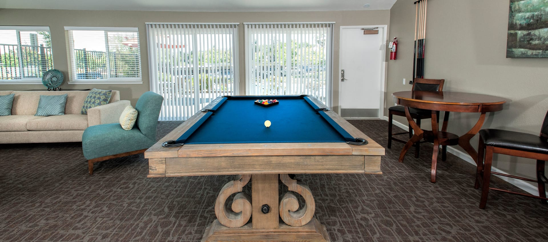 Community clubhouse with a pool table at Ridgecrest Apartment Homes in Martinez, California