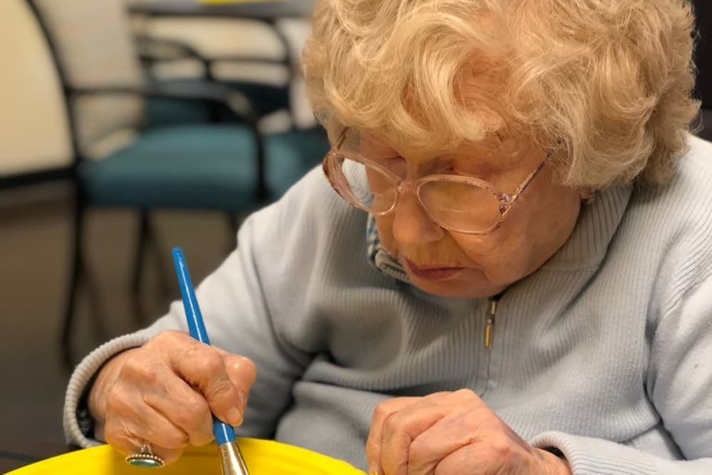 Lady enjoys painting at Genoa Retirement Village in Genoa, Ohio
