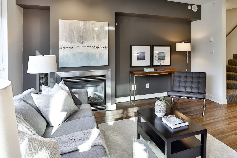 Modern living room with hardwood flooring at Bayview at Coal Harbour in Vancouver, British Columbia