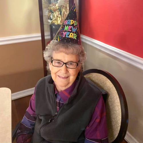 A resident with a birthday hat on at Canoe Brook Assisted Living in Duncan, Oklahoma