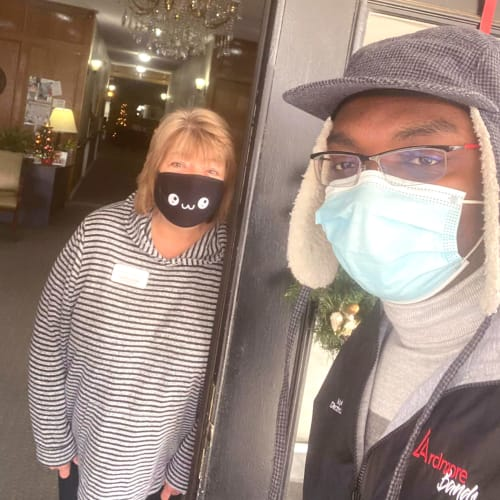 2 Masked caretakers  at Canoe Brook Assisted Living in Ardmore, Oklahoma