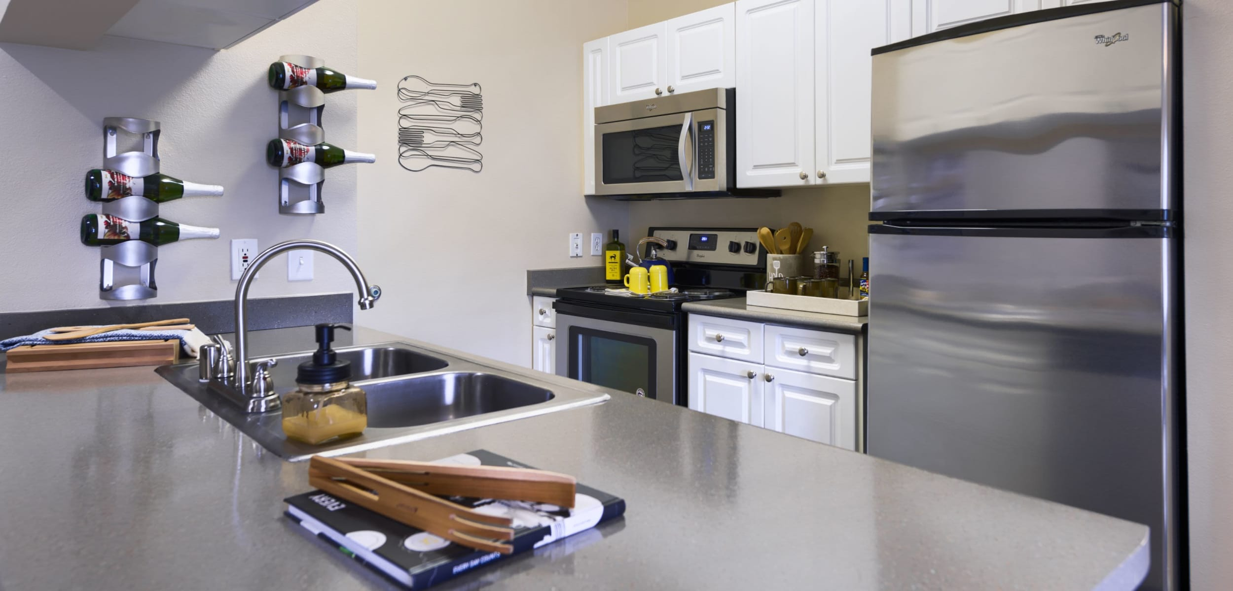 Kitchen with modern appliances at Whisper Creek Apartment Homes in Lakewood, Colorado