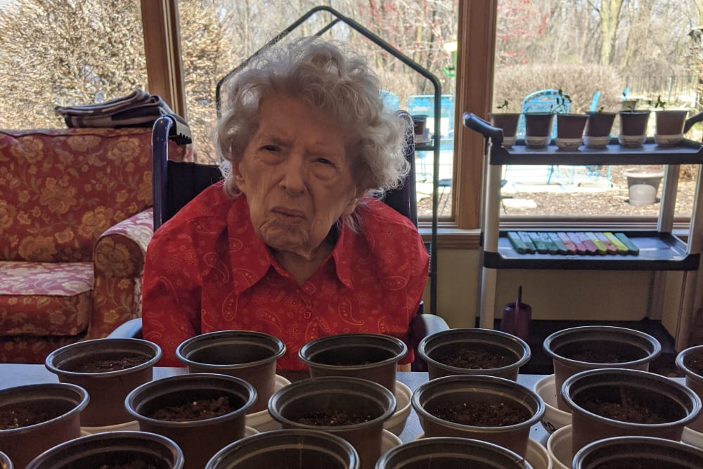 Resident participates in a gardening activity at Ramsey Woods in Cudahy, Wisconsin.