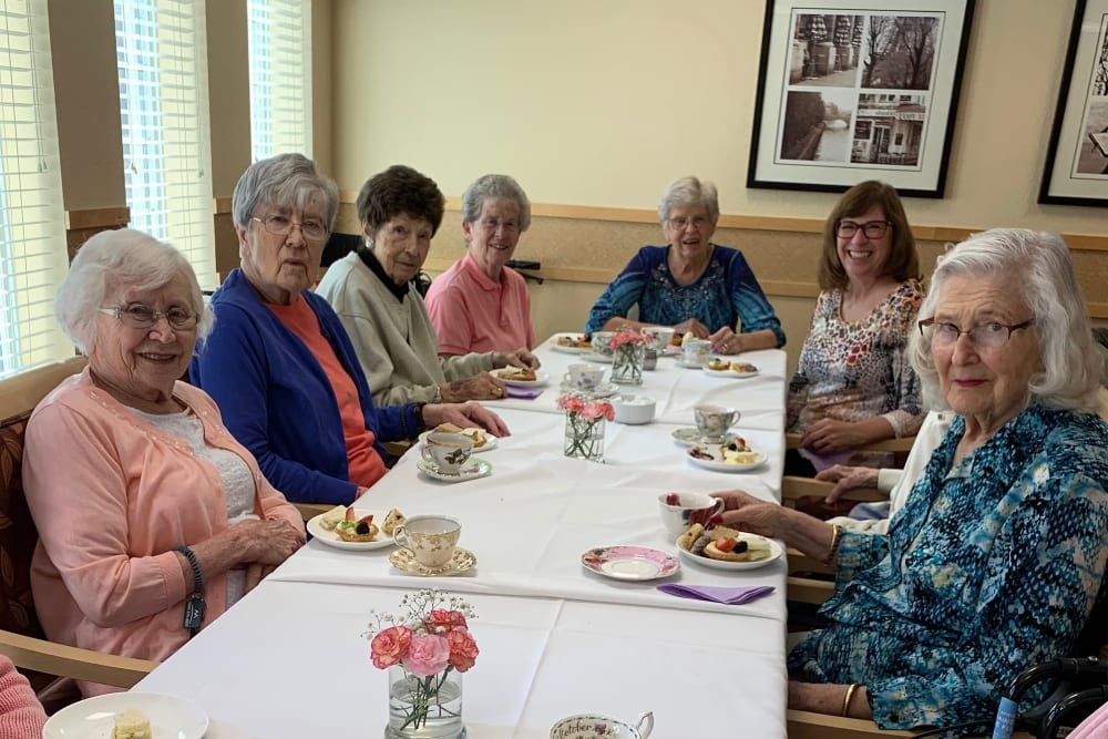 Resident friends enjoying a meal at Merrill Gardens at Willow Glen in San Jose, California.