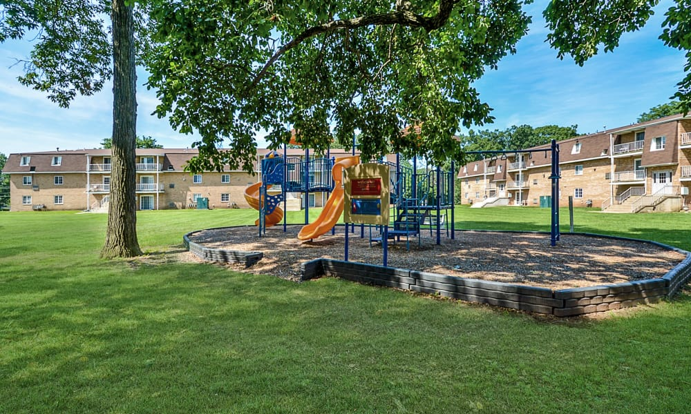 Enjoy apartments with a playground at Main Street Apartment Homes