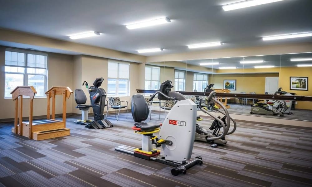 Modern fitness center with large windows at The Sanctuary at West St. Paul in West St. Paul, Minnesota