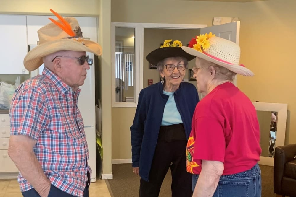 Residents with fun hats on at The Wellington in Minot, North Dakota