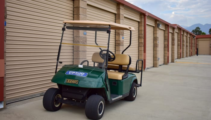 A golf cart in front of exterior storage units at STOR-N-LOCK Self Storage in Redlands, California