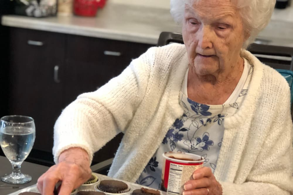 Female resident baking chocolate cupcakes at Springview Manor in Lima, Ohio