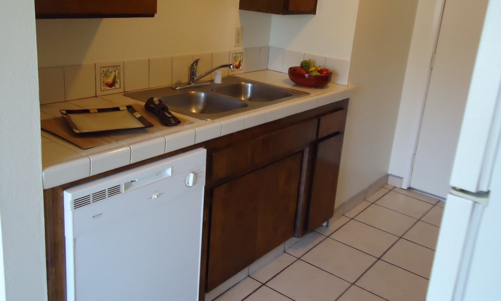 Modern kitchen at Olympus Court Apartments in Bakersfield, California