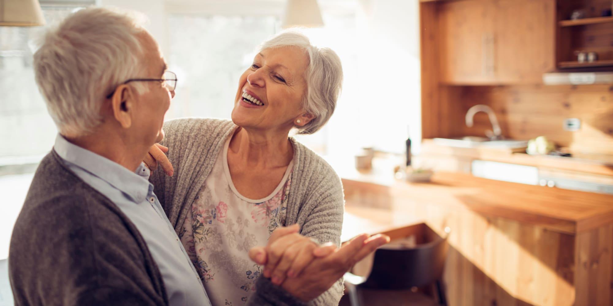 Two residents dancing at Avenir Senior Living in Scottsdale, Arizona.
