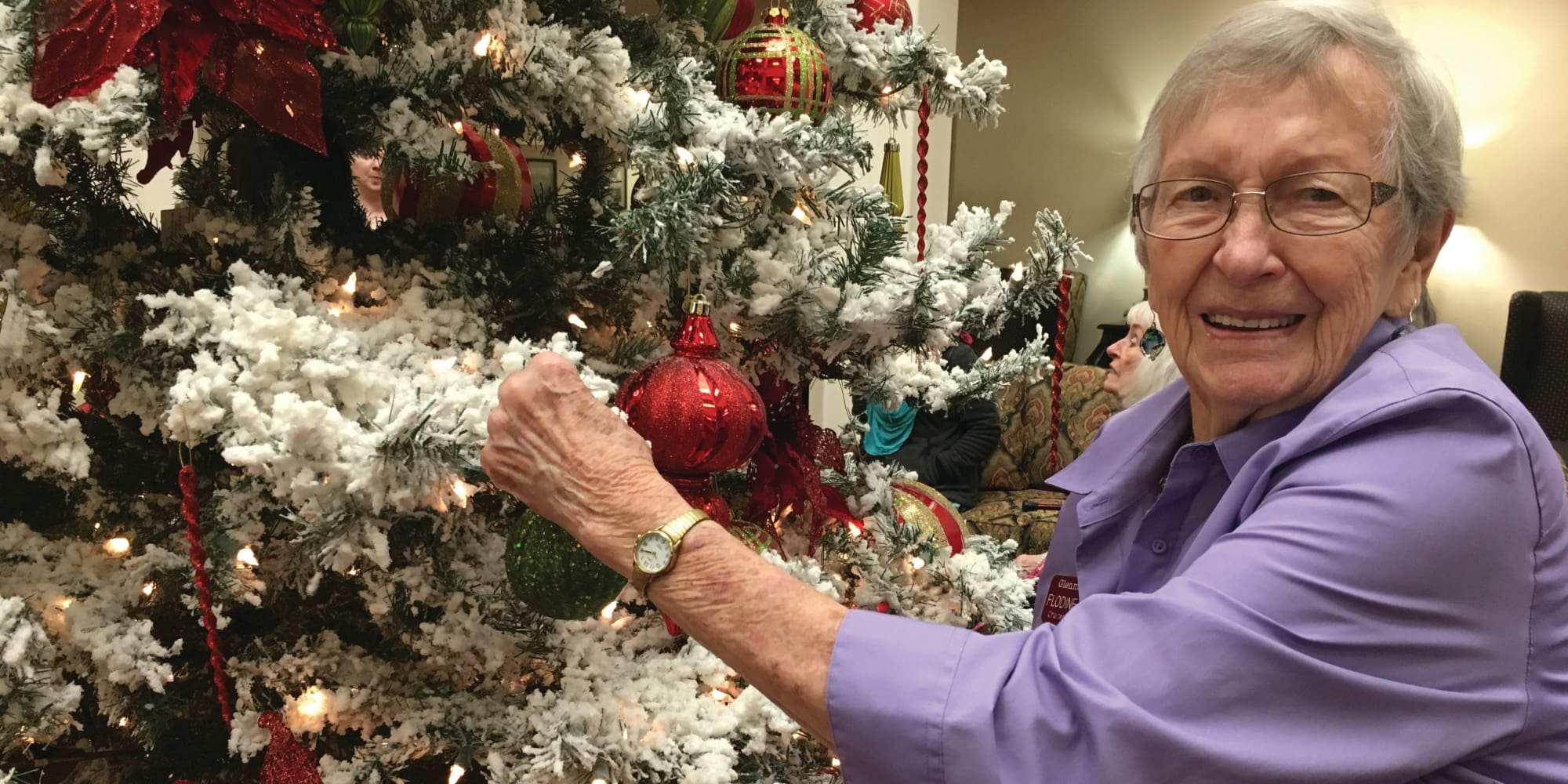 A resident decorating a tree at Mulberry Gardens Memory Care in Munroe Falls, Ohio