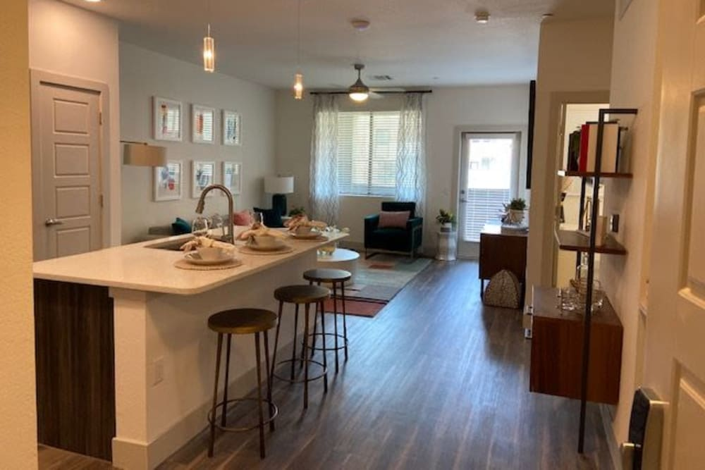 Breakfast Bar And Living Room At The District at Chandler In Chandler, Arizona
