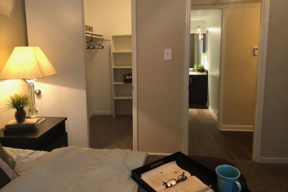 Walk-in closet in a bedroom at The Reserve at City Center North in Houston, Texas