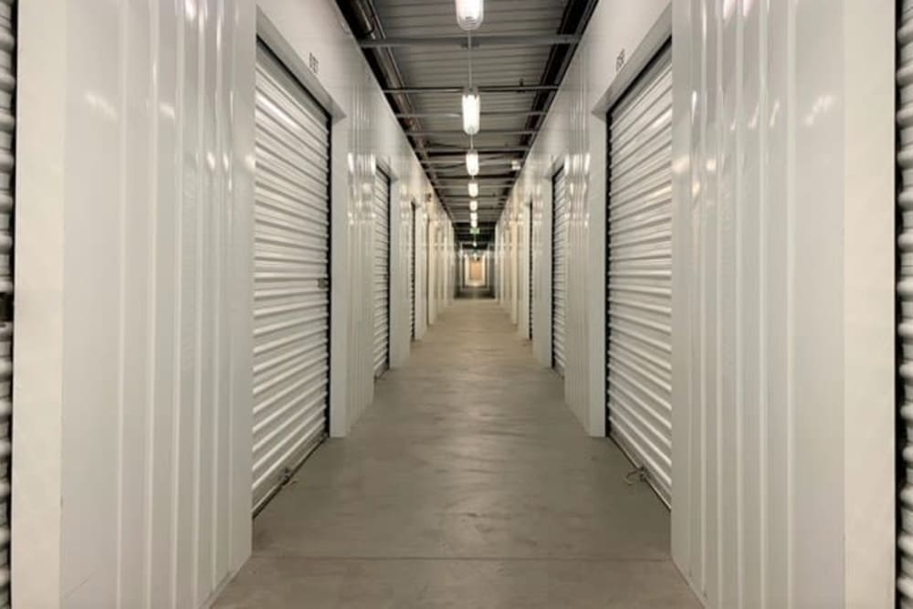 Interior units with white doors at Trojan Storage in Salinas, California