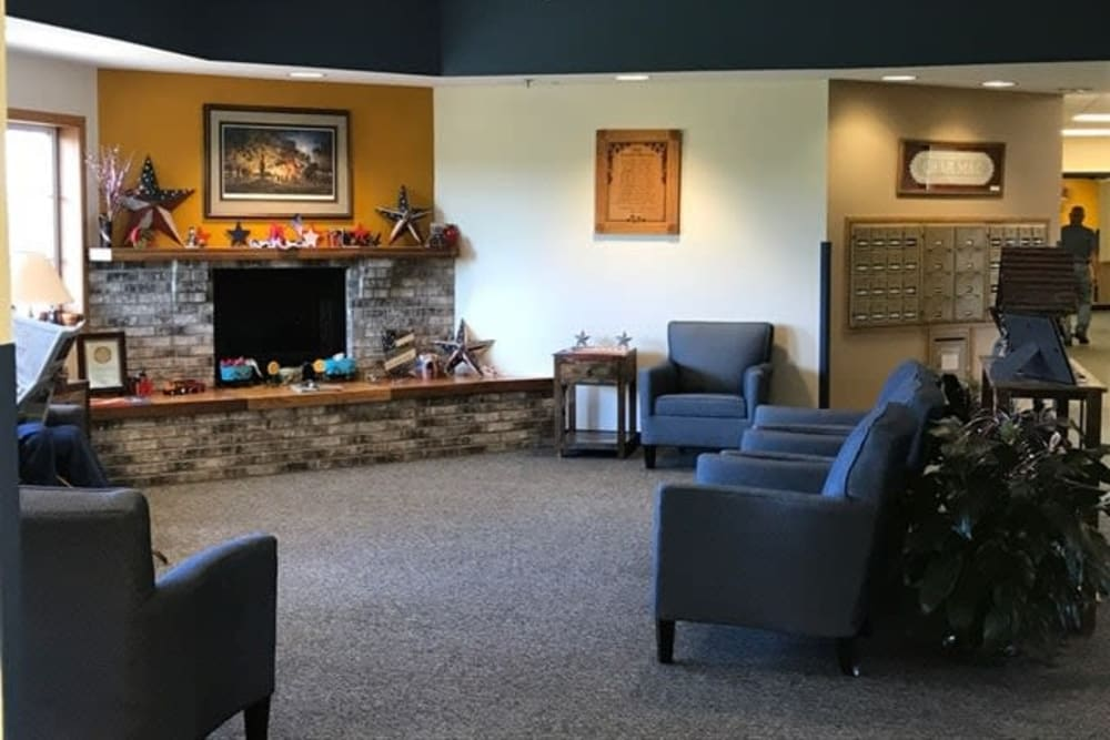 Comfortable lobby with fireplace at Lawton Senior Living in Lawton, Iowa.