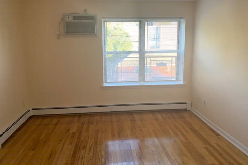 Room with hardwood floors at The Central House in Ridgefield Park, New Jersey