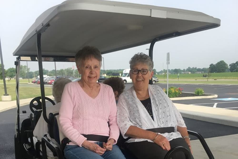 Female residents taking a group ride in a golf cart at The Meadows of Ottawa in Ottawa, Ohio