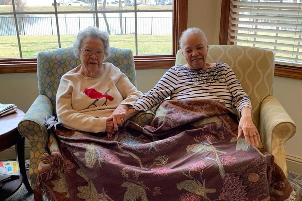 Two residents sitting under a blanket at Oak Pointe of Warrenton in Warrenton, Missouri