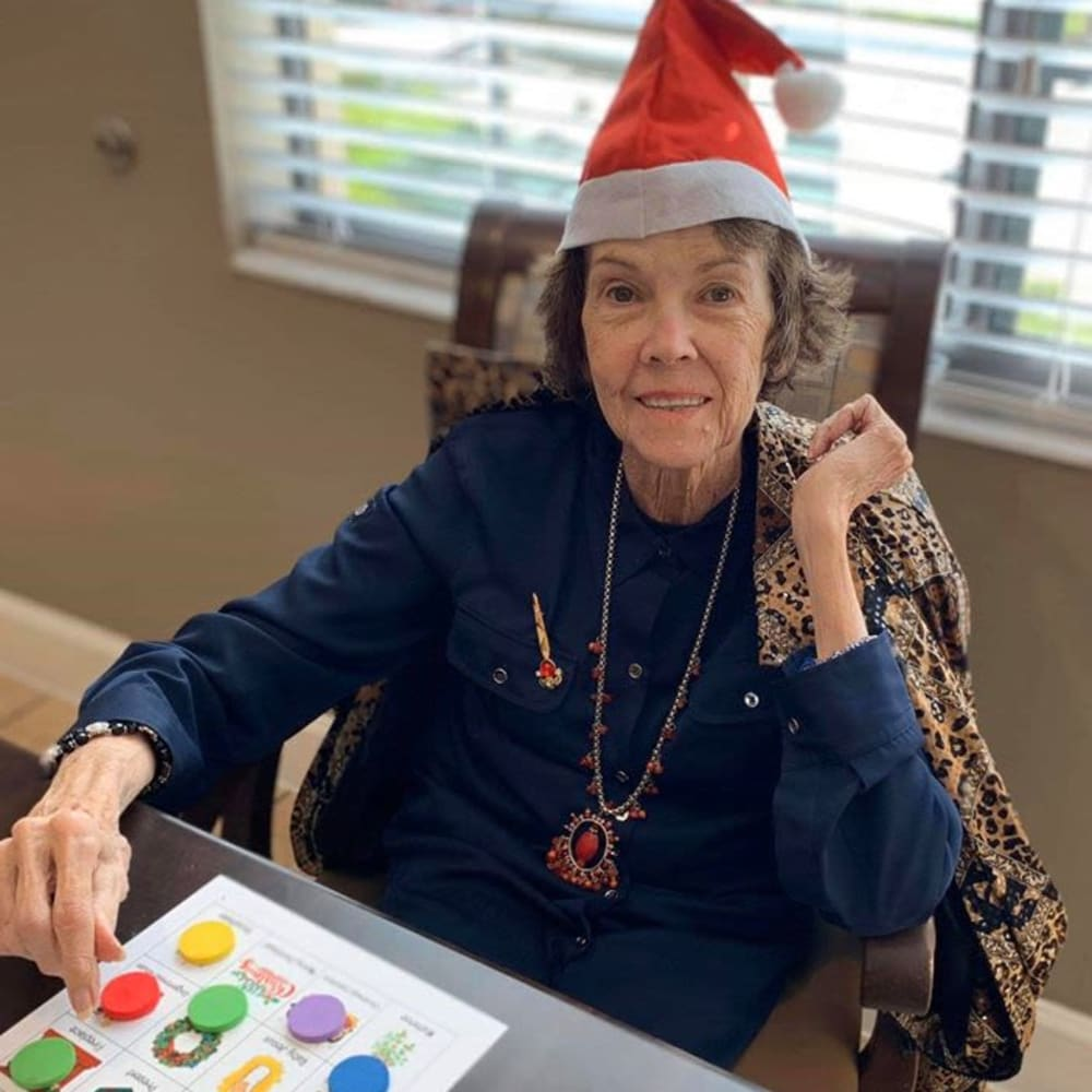 A resident playing a game at Inspired Living Ivy Ridge in St Petersburg, Florida