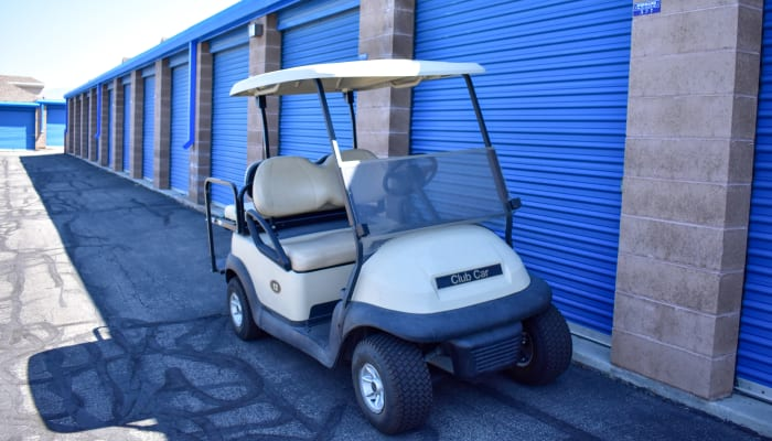 A golf cart in front of exterior storage units at STOR-N-LOCK Self Storage in Cottonwood Heights, Utah