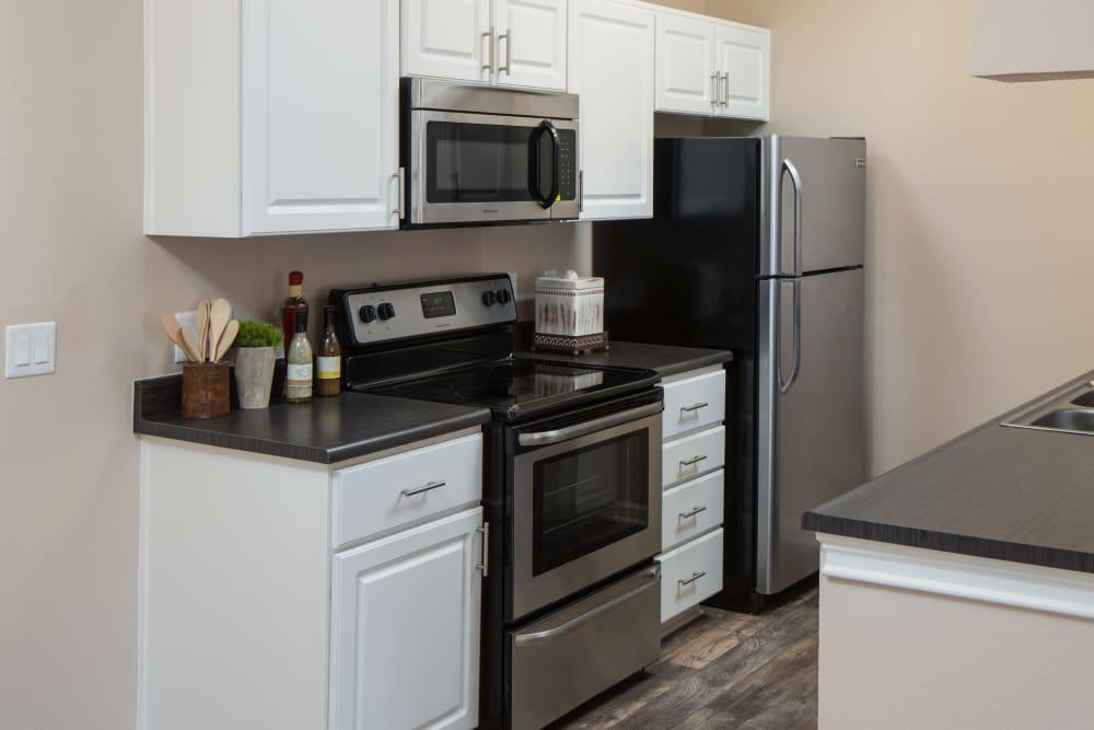 A Luxury apartment kitchen at Alicante Apartment Homes in Aliso Viejo, California