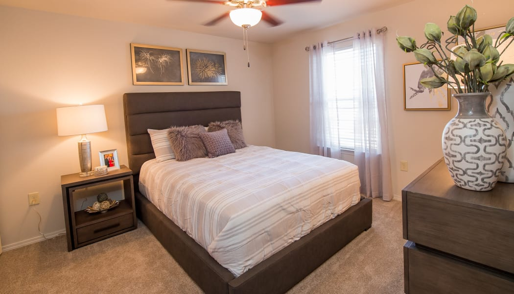 Master bedroom at Cottages at Tallgrass Point Apartments in Owasso, Oklahoma