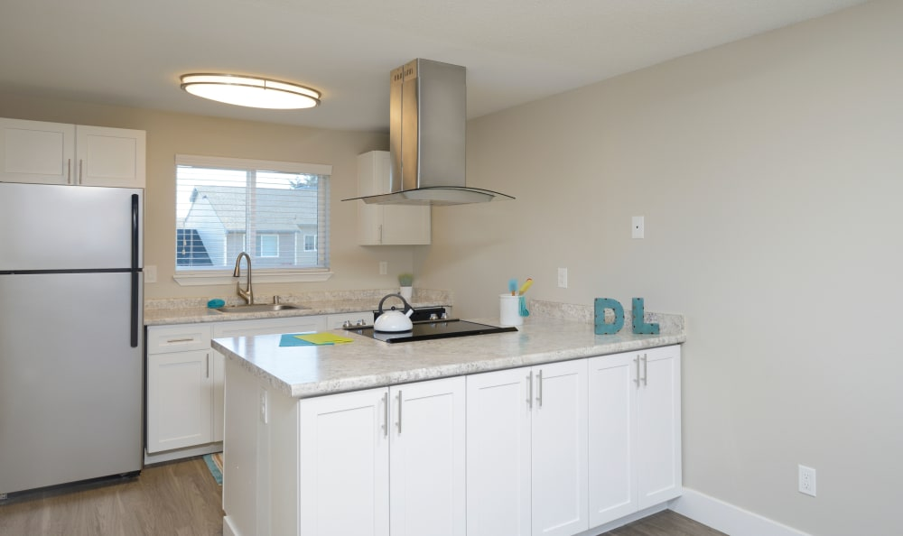 Kitchen at Discovery Landing Apartment Homes in Burien, WA