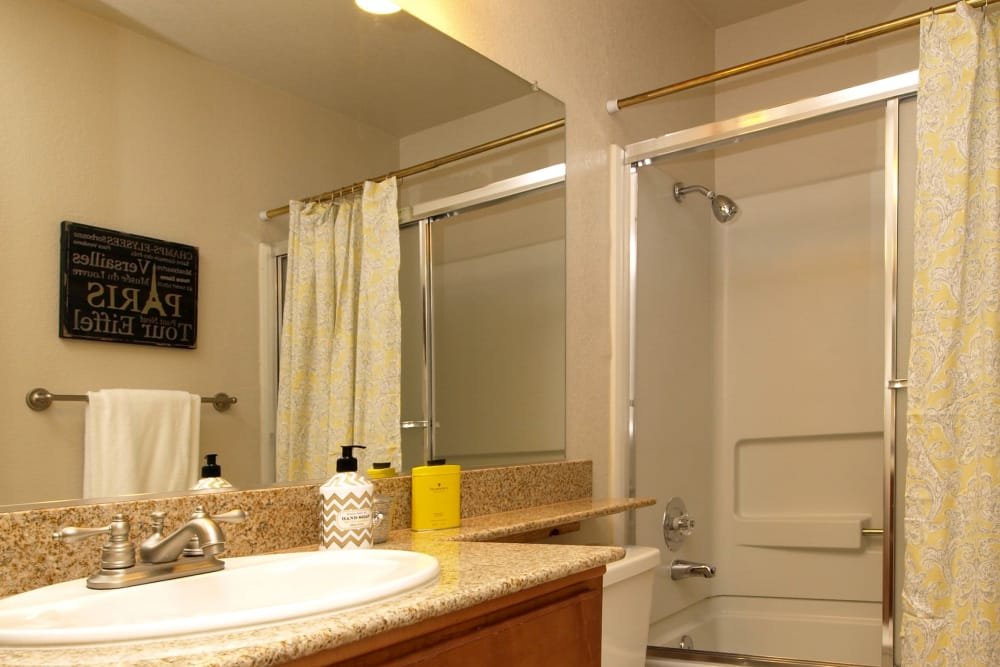 Lovely model bathroom at Deer Valley Apartment Homes in Roseville, California