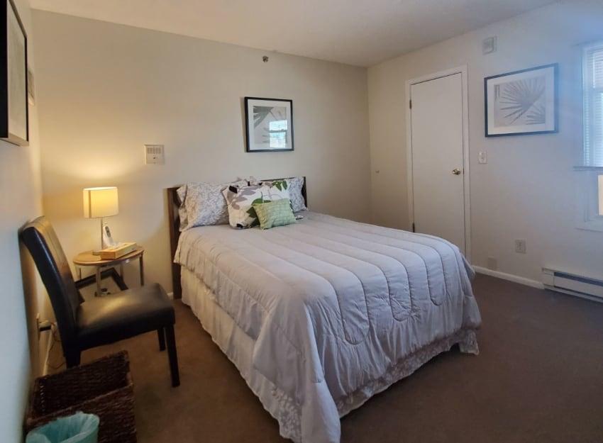 A model bedroom at Inglenook At Brighton in Brighton, Colorado