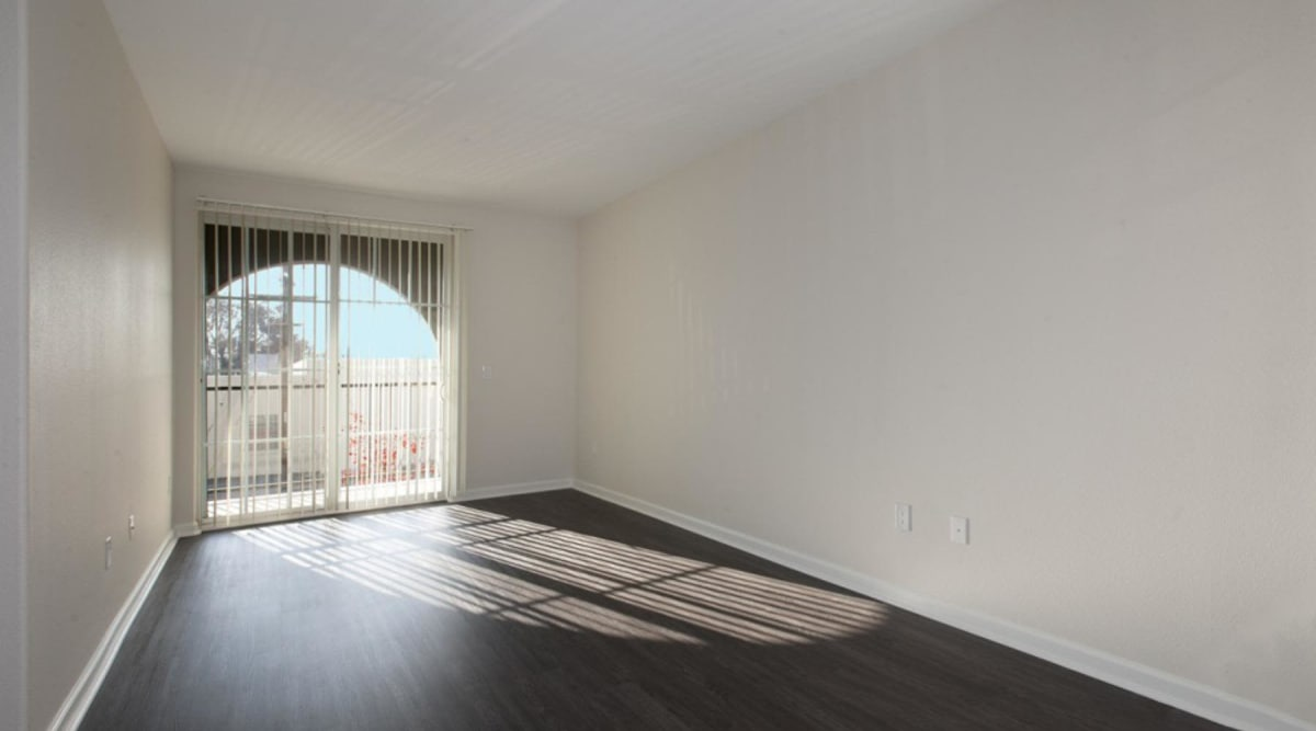 Living room with large sunny window at Park Central in Concord, California