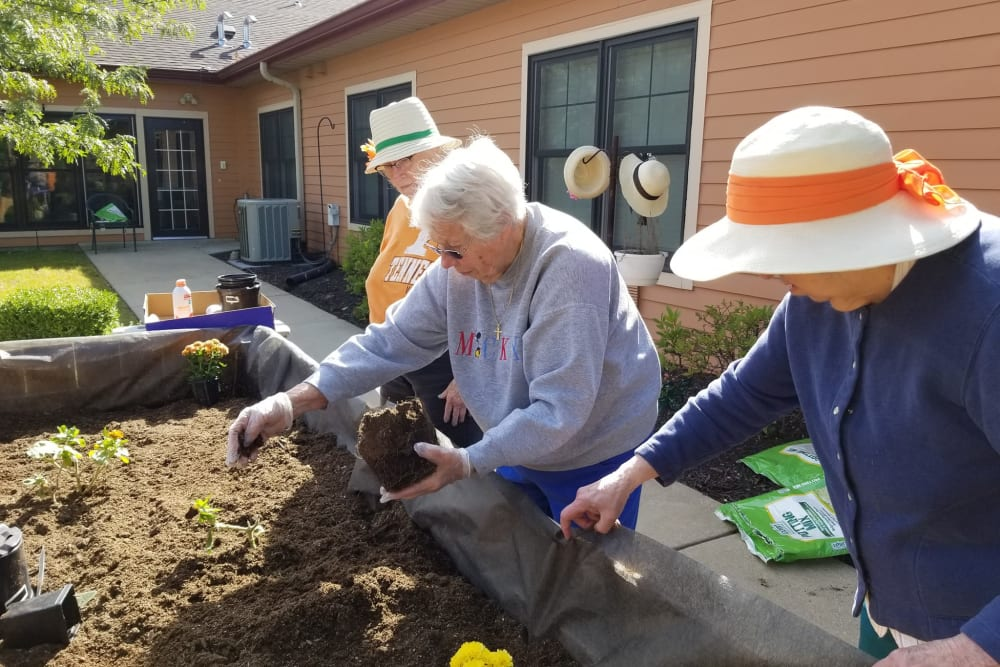Residents gardening at The Meadowlands in O'Fallon, Missouri