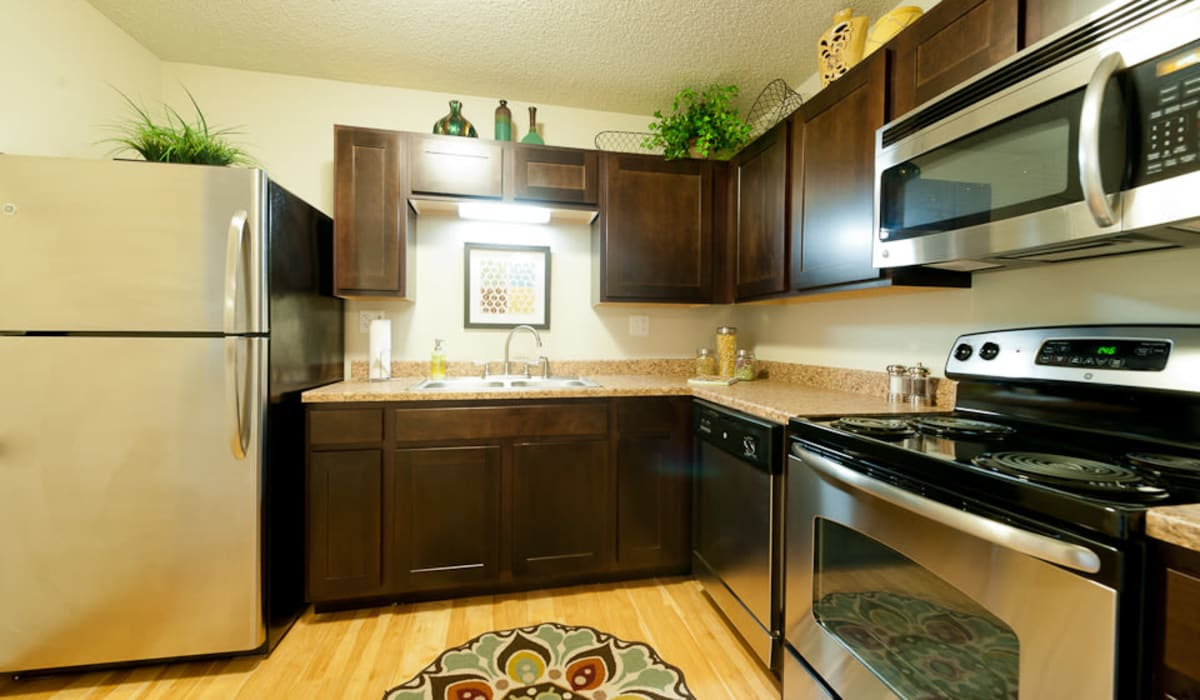 A spacious kitchen with stainless-steel refrigerator at Pointe West Apartment Homes in West Des Moines, Iowa