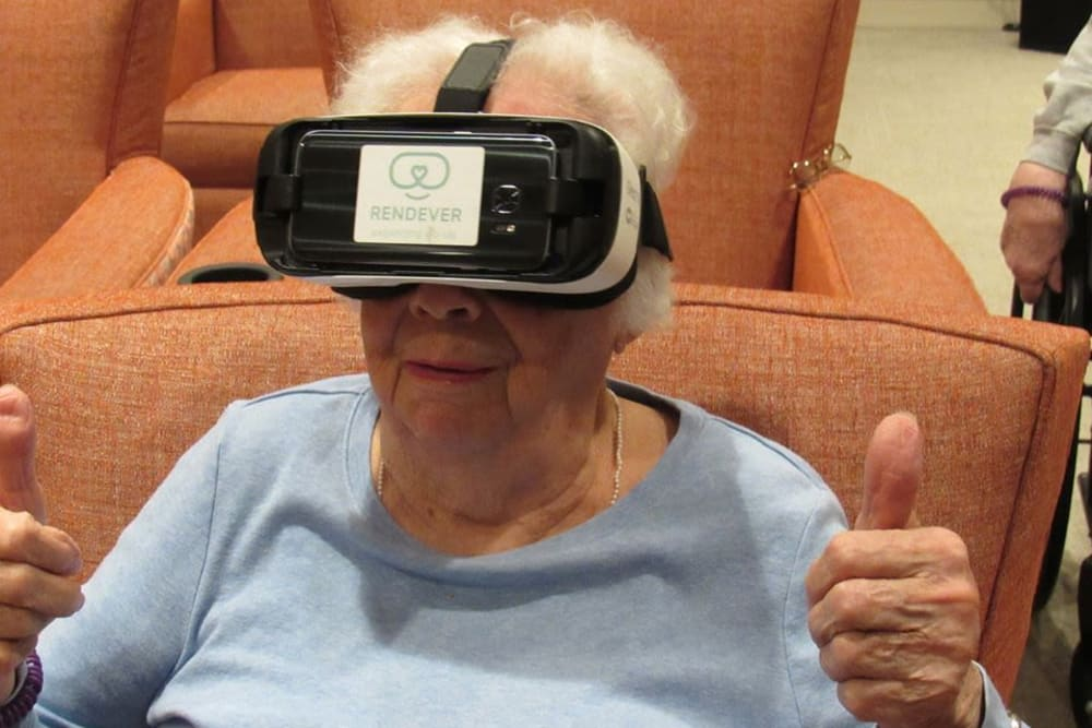 Resident with VR headset at Aspired Living of Westmont