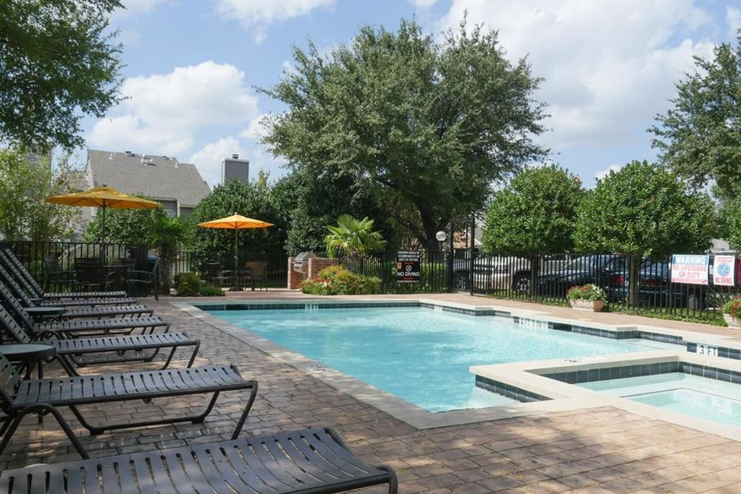 Gorgeous swimming pool area on a beautiful day at The Park at Ashford in Arlington, Texas