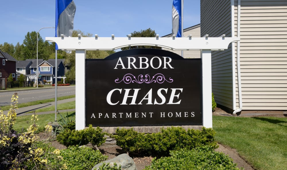 Apartment sign at Arbor Chase Apartment Homes in Kent, WA