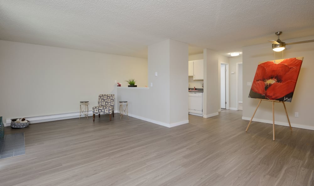 Living room offers hardwood flooring at Arbor Chase Apartment Homes in Kent, WA