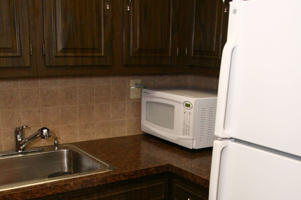 Refrigerator and microwave oven at Terrace Lake Apartments in Bradley Beach, NJ