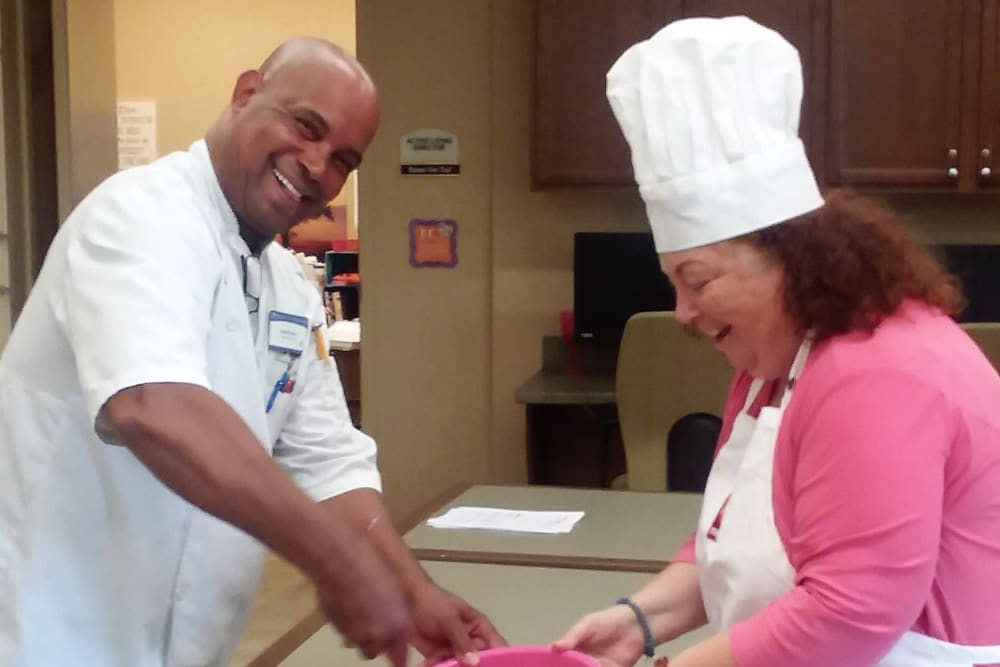 Executive Chef making cookies with residents at Merrill Gardens at Huntington Beach in Huntington Beach, California
