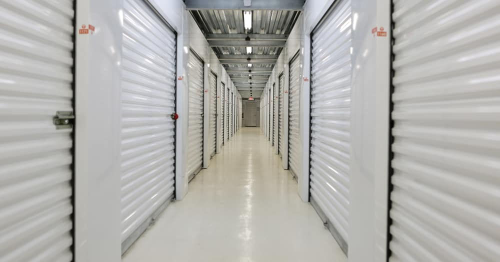 Storage units with white doors at Midgard Self Storage in Key West, Florida