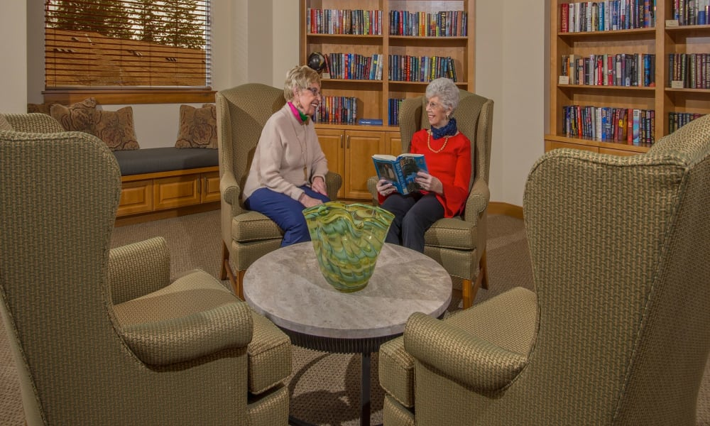 Comfortable seating in the library at Quail Park of Lynnwood in Lynnwood, Washington