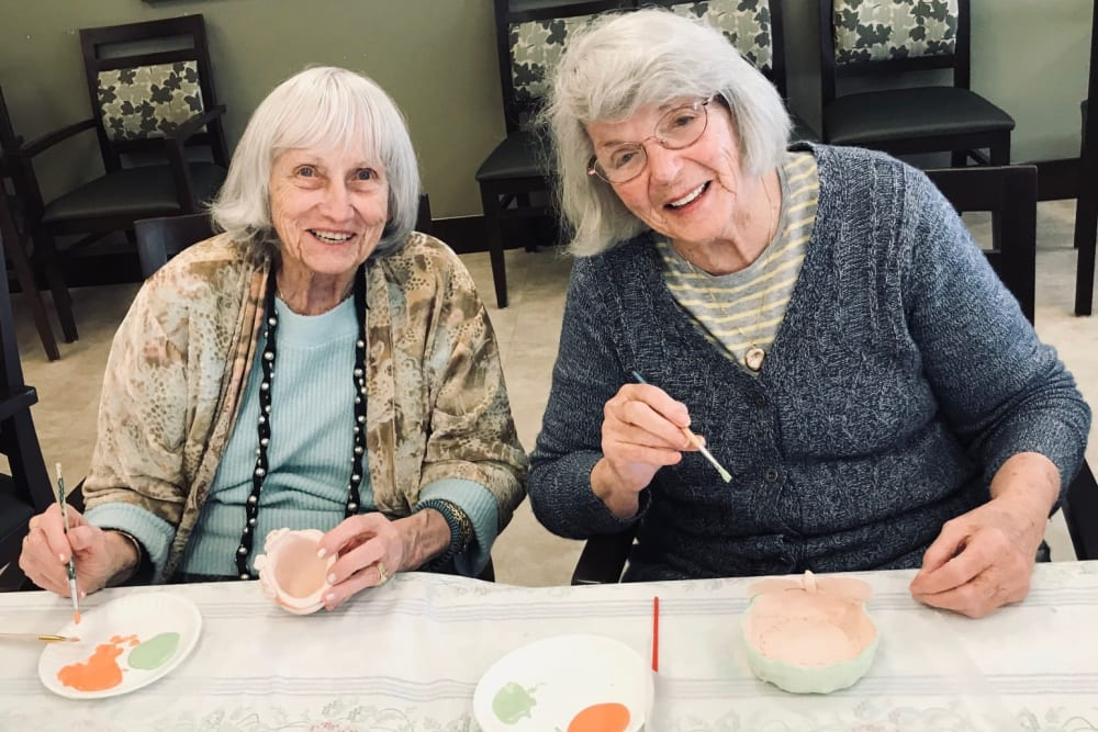 Two residents enjoying time together at Merrill Gardens at Lafayette in Lafayette, California.
