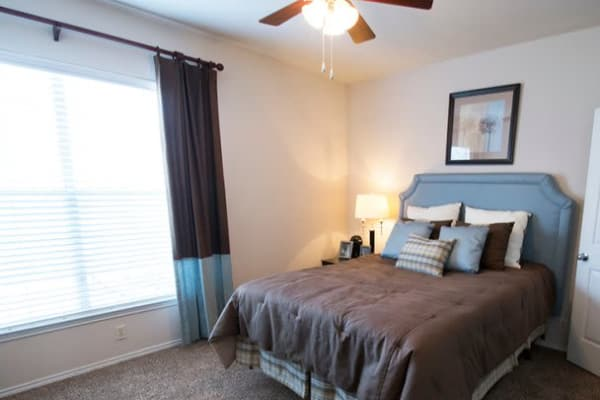 Sun-lit bedroom at Stonehaven Villas in Tulsa, Oklahoma