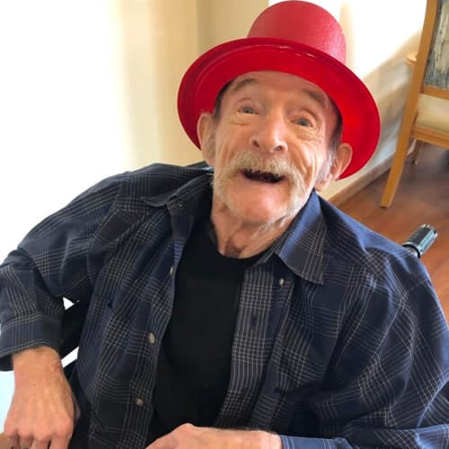 An excited resident wearing a red bucket cap Ashbrook Village in Duncan, Oklahoma